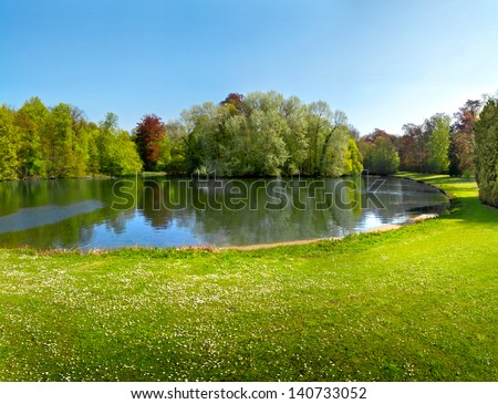 Spring Park. Lake in the spring park. Spring landscape.   - stock photo