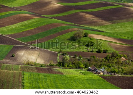 Spring plowing land near a house