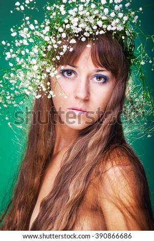 spring portrait girl with wreath of flowers - stock photo