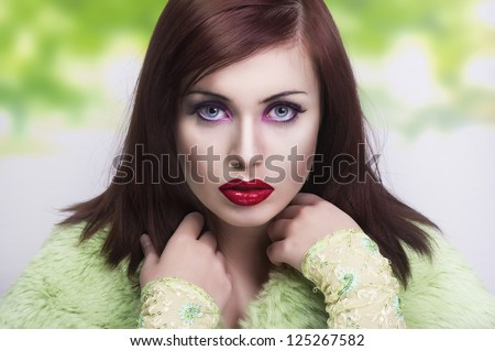 Spring portrait of a young brunette - stock photo