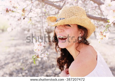 Spring portrait of beautiful 40 years old woman outdoors - stock photo