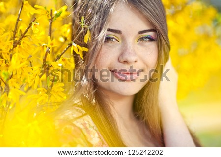 Spring portrait with flowers - stock photo