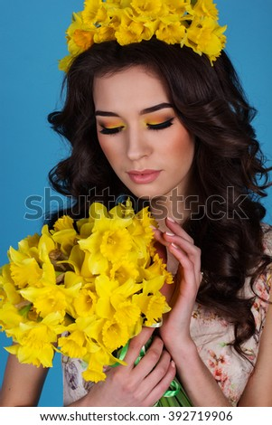 Spring queen with bouquet of yellow daffodil flowers - stock photo