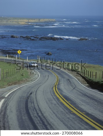 Spring Road on Route 1 Pacific Coast Highway in California with view of the Pacific Ocean - stock photo
