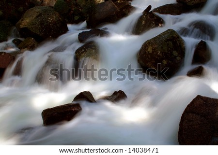 Spring run off on Fall Creek as it pours into Payette Lake, McCall Idaho - stock photo