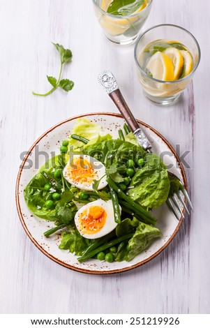 Spring salad with green beans,pea and eggs - stock photo