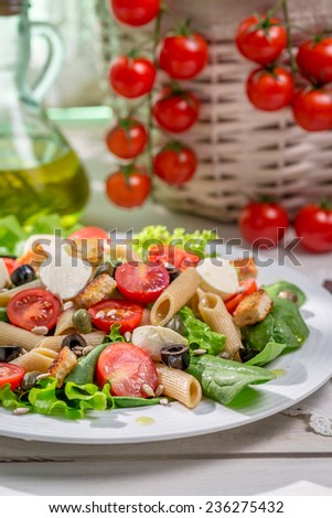 Spring salad with pasta - stock photo
