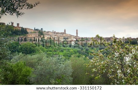 Spring scenery of old town of Montalcino in Val d'Orcia area - stock photo