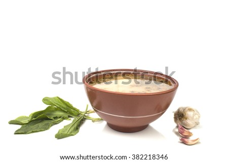 Spring soup with sorrel - stock photo