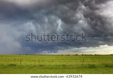 Spring Storm A storm front rolls through the plains. Horizontal. - stock photo