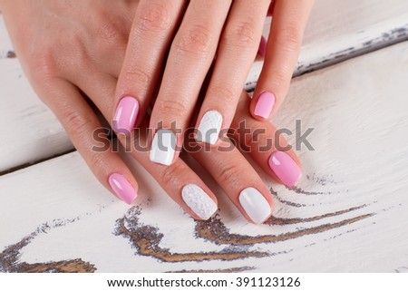 Spring stylish manicure closeup. Trendy white-pink manicure.