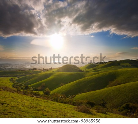 Spring sunset in lush green meadow in California, viewing the San Francisco Bay from the foothills of the Diablo Range