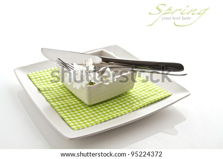 Spring table setting isolated on white with space for text - stock photo