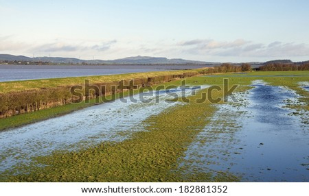 Spring Tide and flooded fields at Slimbridge - stock photo