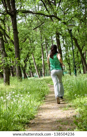Spring time - jogging in the park - stock photo