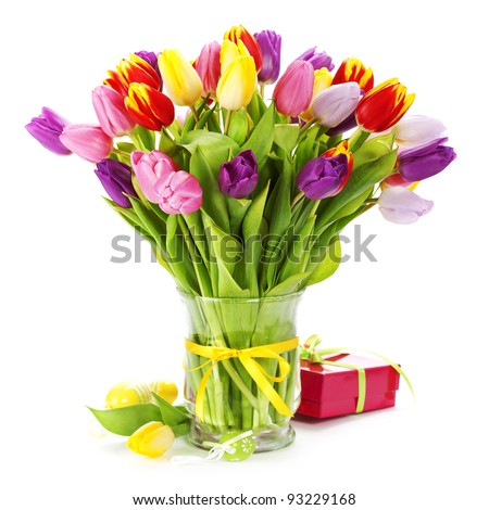 spring tulips with easter eggs  on white background