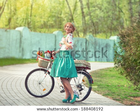 Spring walk. Romantic portrait of a girl with a bicycle