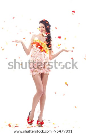 spring woman in floral dress and shoes under falling petals