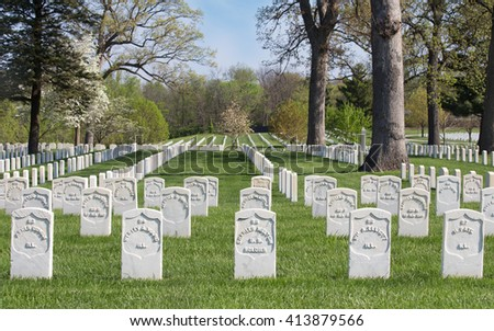 SPRINGFIELD, ILLINOIS/USA-APRIL 25, 2016: Gravestones of Civil War soldiers buried at Camp Butler National Cemetery - stock photo