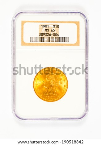 SPRINGFIELD, OR - ARPIL 2, 2014: 1901 10 dollar gold Liberty Head coin in case graded MS65 by NGC. - stock photo