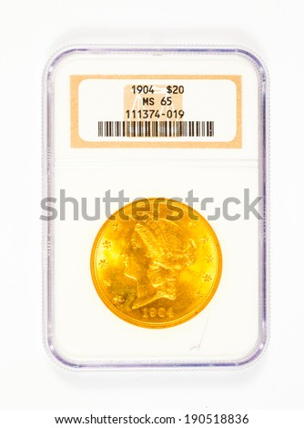 SPRINGFIELD, OR - ARPIL 2, 2014: 1904 gold 20 dollar Liberty Head coin graded MS65 by NGC. - stock photo