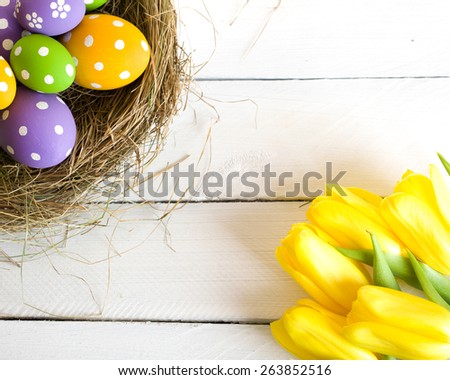 Springtime Easter nest with eggs over a wood background - stock photo