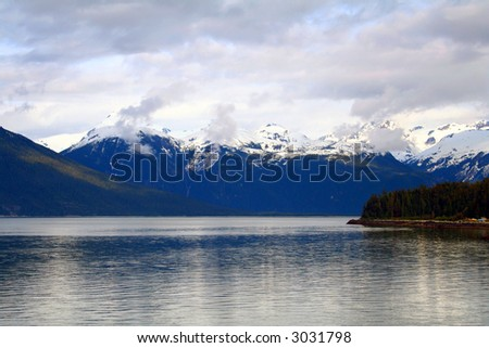 Springtime view of snow capped mountains from Alaska's inside passage.