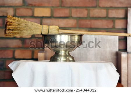 Sprinkler and holy water in the church during Easter - stock photo