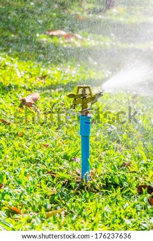 sprinkler head watering in the garden - stock photo