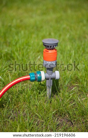Sprinkler in garden close up - stock photo
