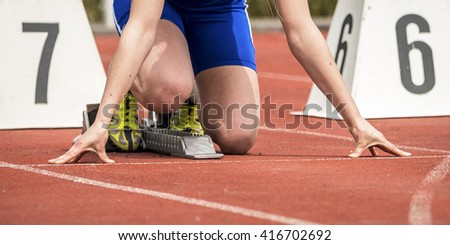 sprinstart in track and field - stock photo