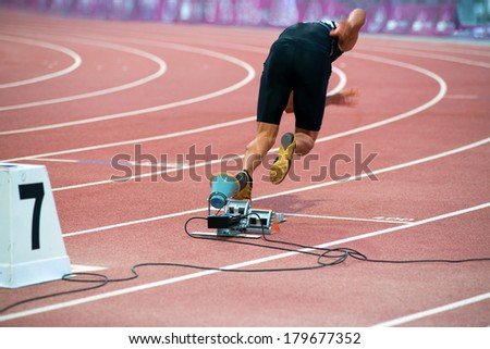 sprinter in the starting blocks - stock photo
