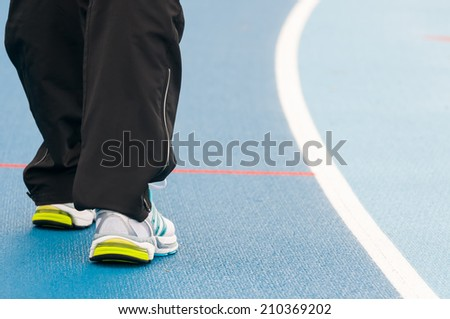 Sprinter preparing for a run on track. - stock photo