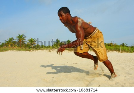 Sprinter Taking Off On The Sand