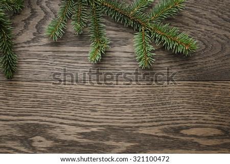 spruce twig on oak table, christmas, christmas background - stock photo