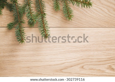 spruce twig on old table, vintage toned photo - stock photo