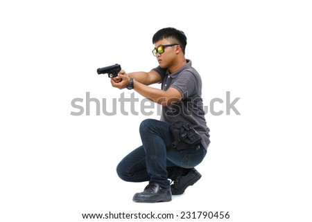 Spy man in the mission, Killer mission, Portrait Of Young Man With Gun On White Background - stock photo