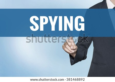 Spying word on virtual screen touch by business woman blue background - stock photo