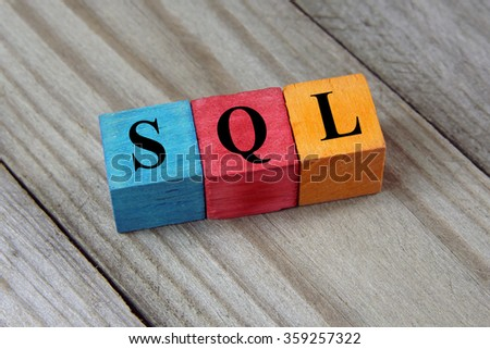 SQL text (Structured Query Language) on colorful wooden cubes - stock photo