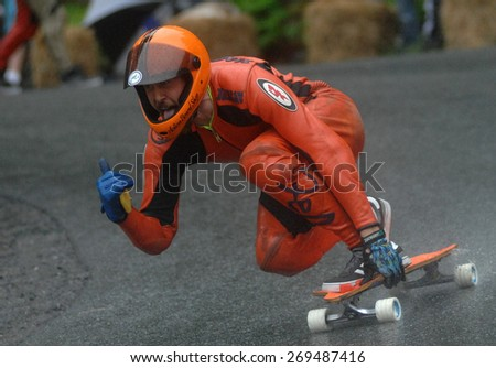 SQUAMISH, BC, CANADA - MAY 25, 2014: Racers compete at the 2014 Britannia Classic Longboard Race in Squamish, BC, Canada, on May 25, 2014.  - stock photo