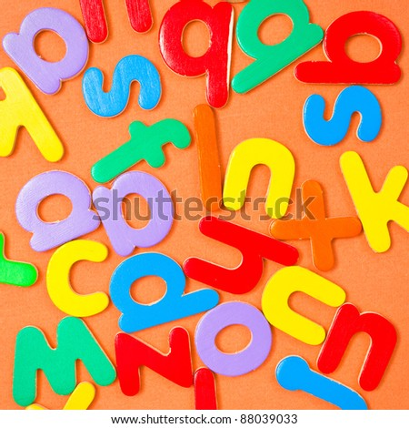 Square background composed of colorful letters of the alphabet