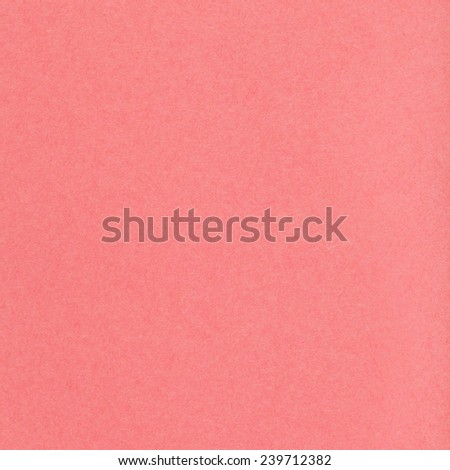square background from sheet of coral colored pastel paper close up - stock photo