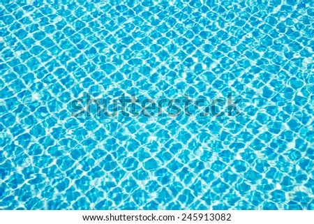 Square blue ceramic in swimming pool under sunlight in summer - stock photo