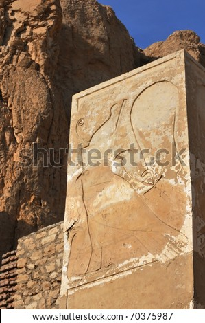 Square column with Horus and cobra at the new kingdom mortuary temple of Queen Hatshepsut at Thebes in Egypt - stock photo