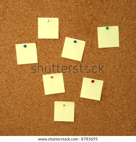 square cork board with seven empty yellow notes