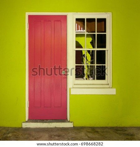 Square Image Of A Hot Pink Door, White Window, And Lime Green Wall.