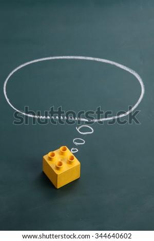square lego block with speech bubble  dream big - stock photo