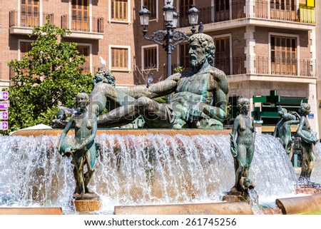 Square of Saint Mary's and fountain Rio Turia  in Valencia in a summer day, Spain - stock photo