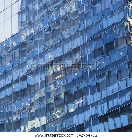 square part of modern shiny blue facade of high rise building in new york city - stock photo
