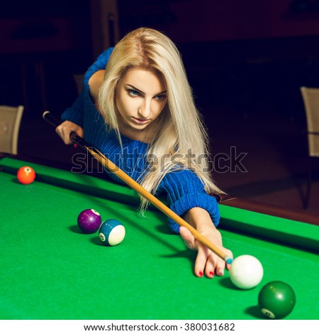 square portrait of a serious young blond woman playing billiards. Billiard sport concept. Pool billiard game. American pool billiard. - stock photo